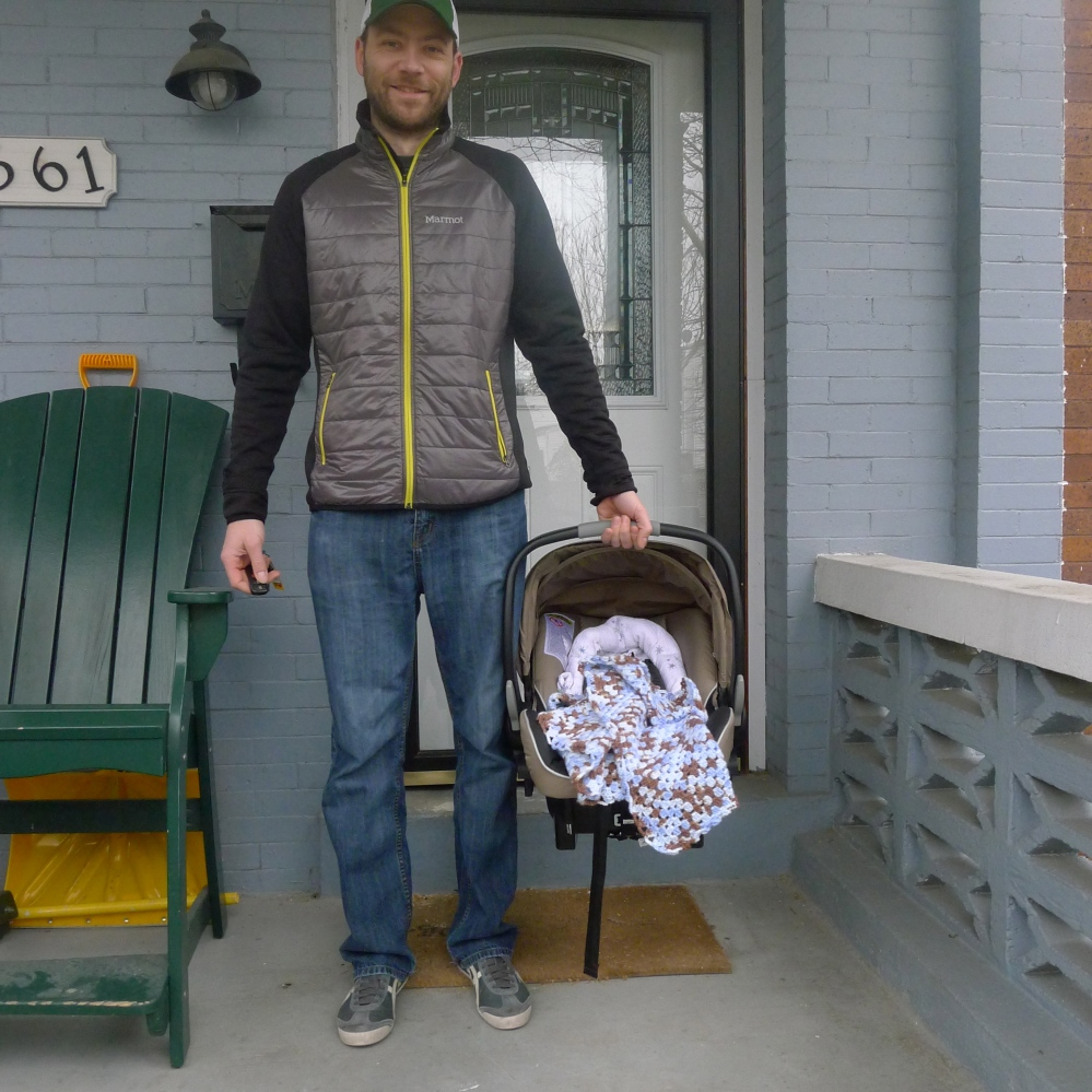 Ryan proudly taking Finn for his first adventure to the pediatrician - we even got snow in March to mark the day!