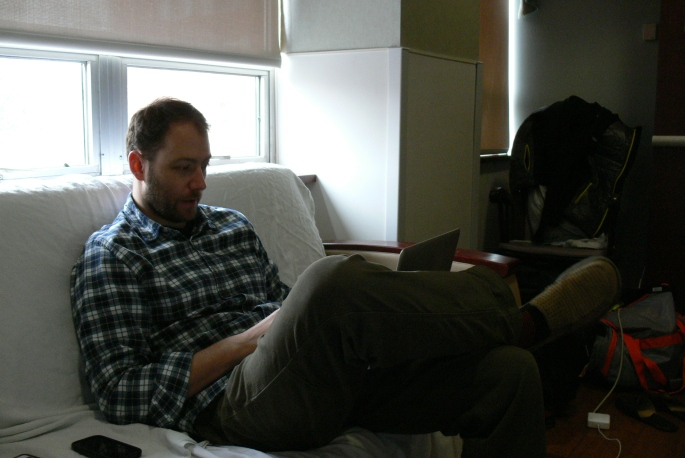 Ryan relaxing and checking email earlier in the day.