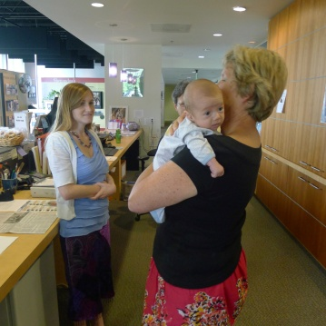 Finn getting passed around at Natasha's job at the Winchester Welcome Center.