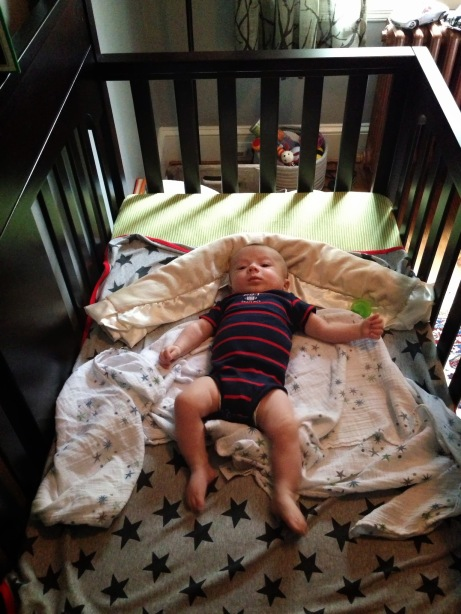 Hanging in his crib!