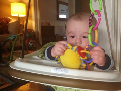Engrossed in his toys.