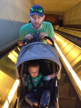 Gripping on for dear life as we tipped him back to go up the escalator!